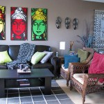 Living room scene highlighing the three Buddha paintings over the sofa