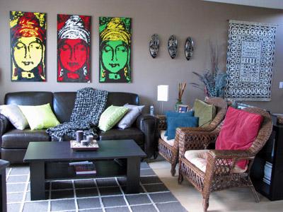 Living room scene highlighing the three Buddha paintings over the sofa